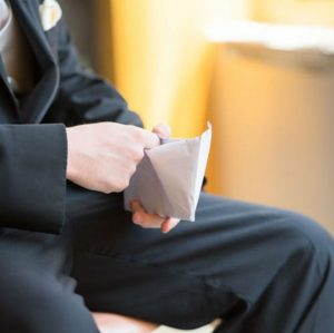 Anti-Bribery man opening envelope